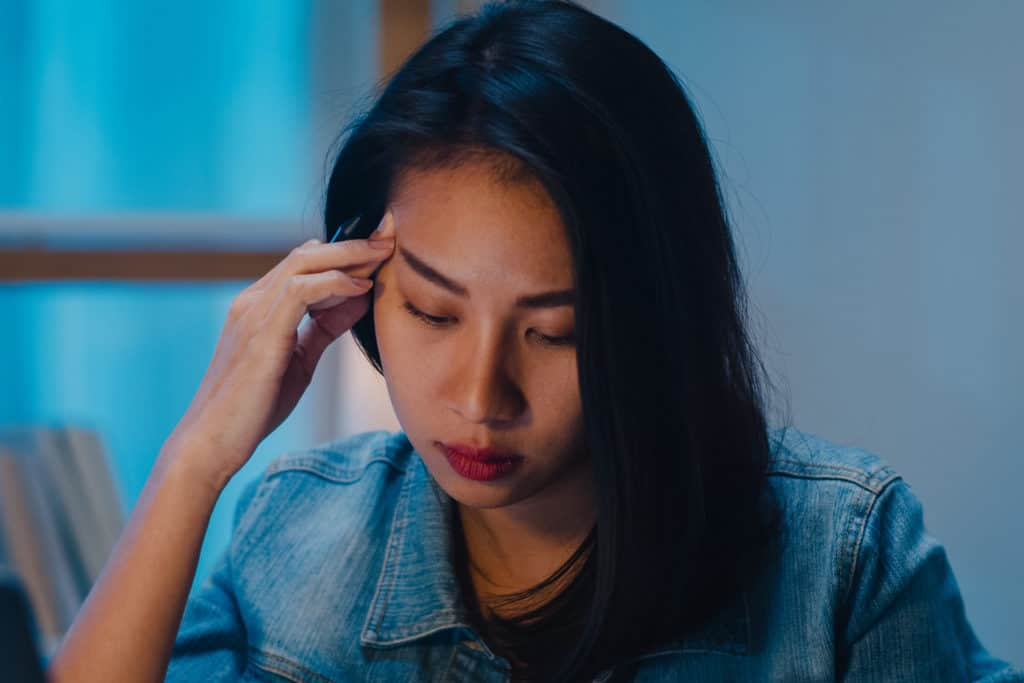 Stressed Out Businesswoman Working Late at Shift Job