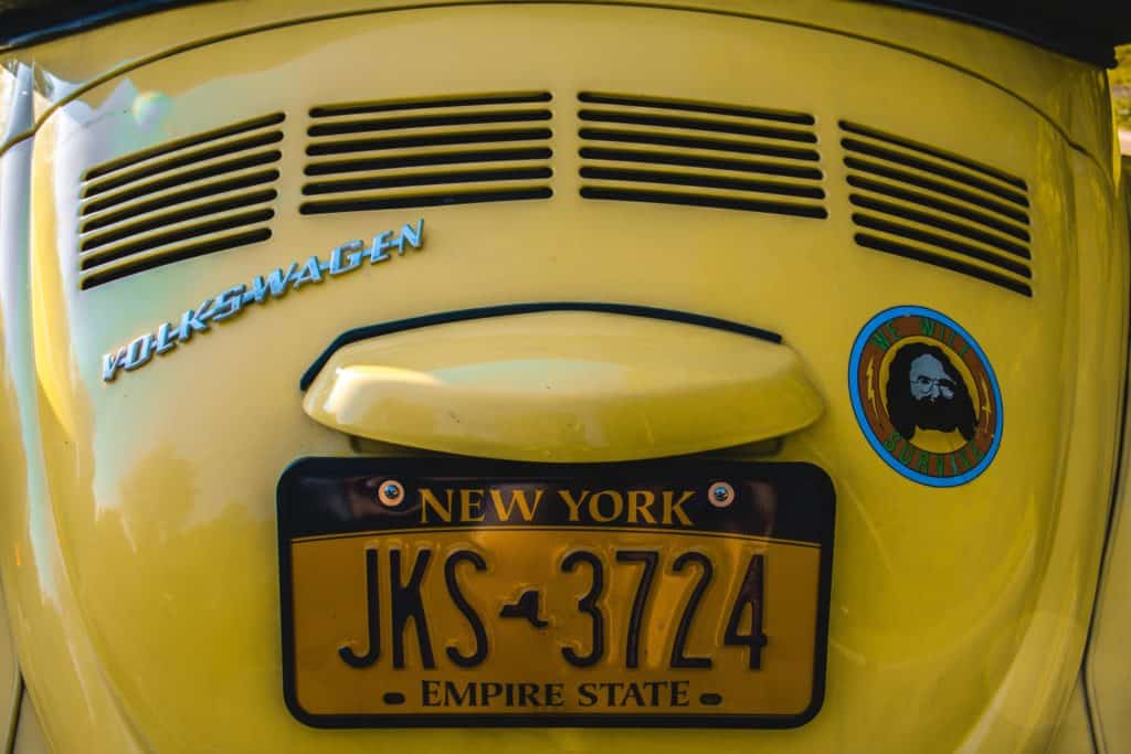 New York License Plate on Yellow Volkswagon