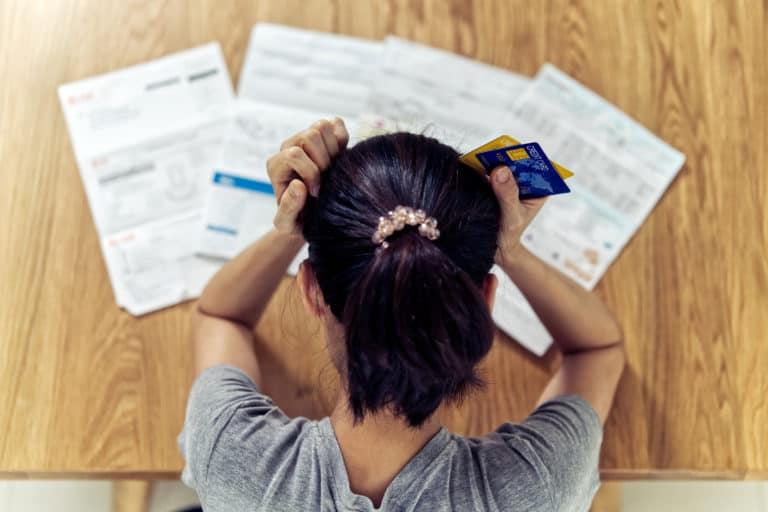 Stressed Young Woman Worrying About Debt